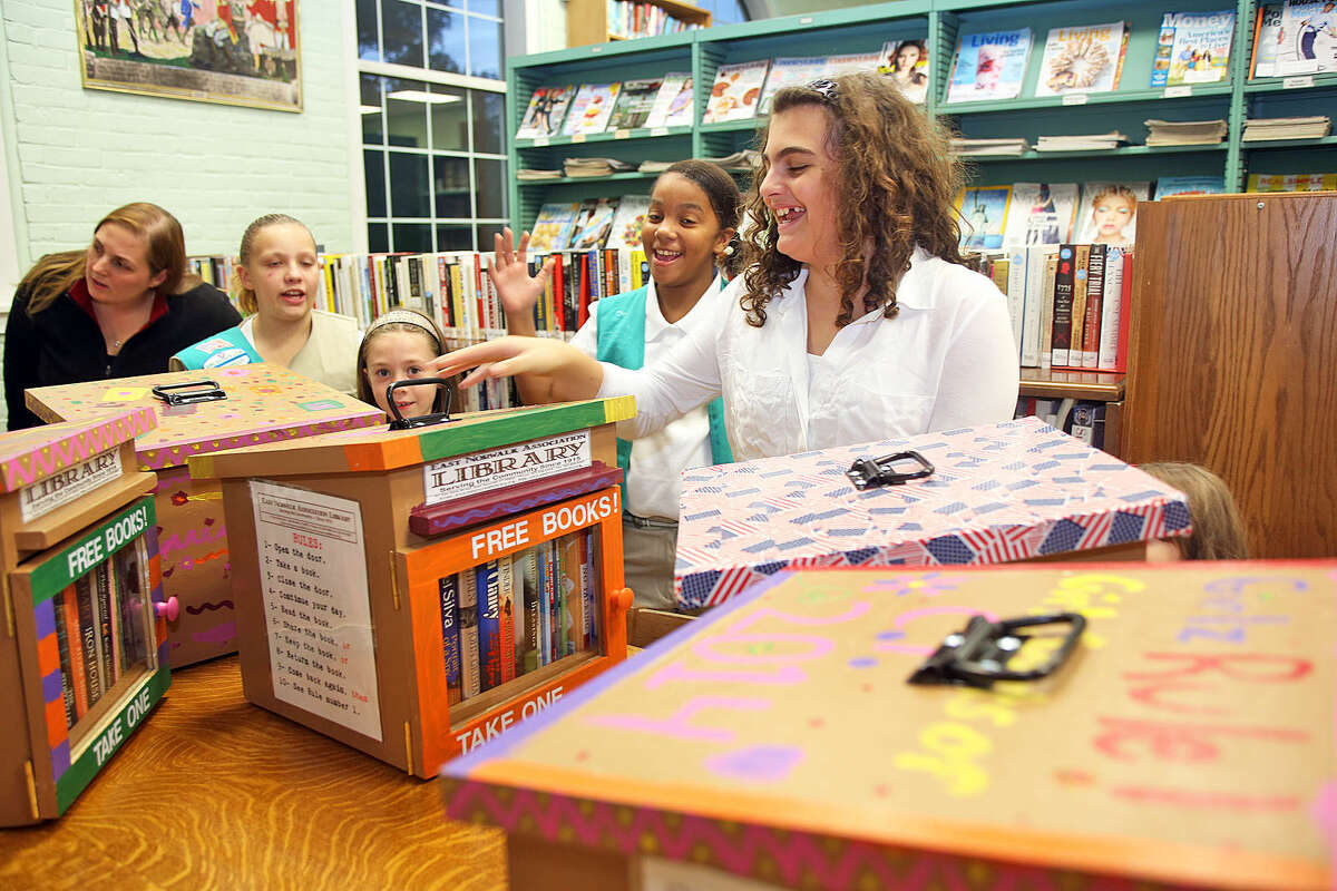 """Girl Scout Jennie Jioia, 11, shows off the book nook that she made at the East Norwalk Library Friday evening. As part of its """"extension services"""" effort, the East Norwalk Association Library will be placing """"Little Free Library"""" Book Nooks are various locations within the East Norwalk Community. Hour Photo / Danielle Calloway"""