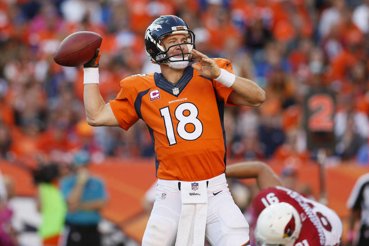 Denver Broncos quarterback Peyton Manning (18) throws against the Arizona Cardinals during the second half of an NFL football game, Sunday, Oct. 5, 2014, in Denver. The Broncos won 41-20. (AP Photo/Joe Mahoney)