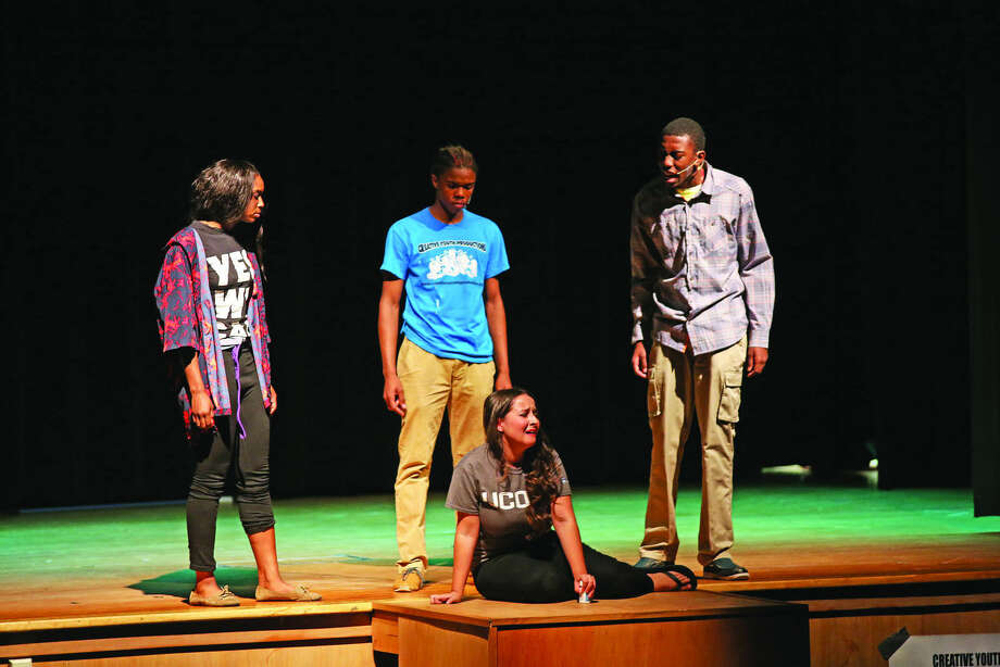 """Creative Youth Productions Performers act out a scene from """"Under The Gun"""" during the CT Stomp The Violenece Youth Conference Center at West Rocks Middle School in Norwalk Friday evening. Hour Photo / Danielle Calloway"""