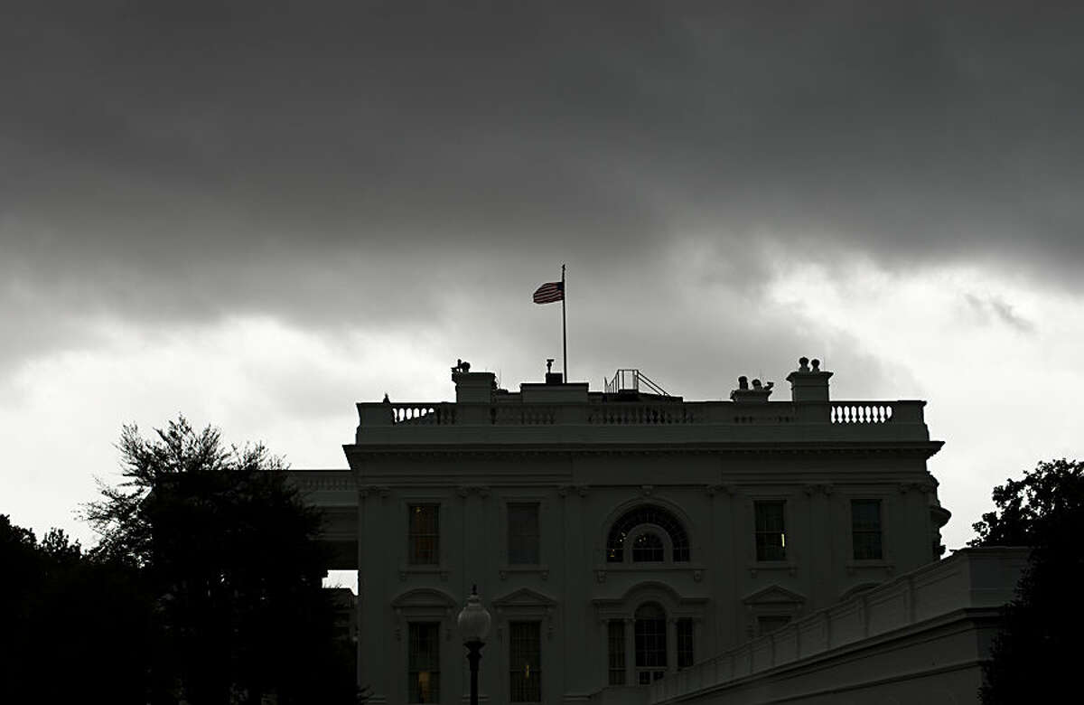 Dark storm clouds are seen over the White House in Washington, Wednesday, Oct. 15, 2014. A tornado warning has been issued for the greater Washington area. (AP Photo/Pablo Martinez Monsivais)