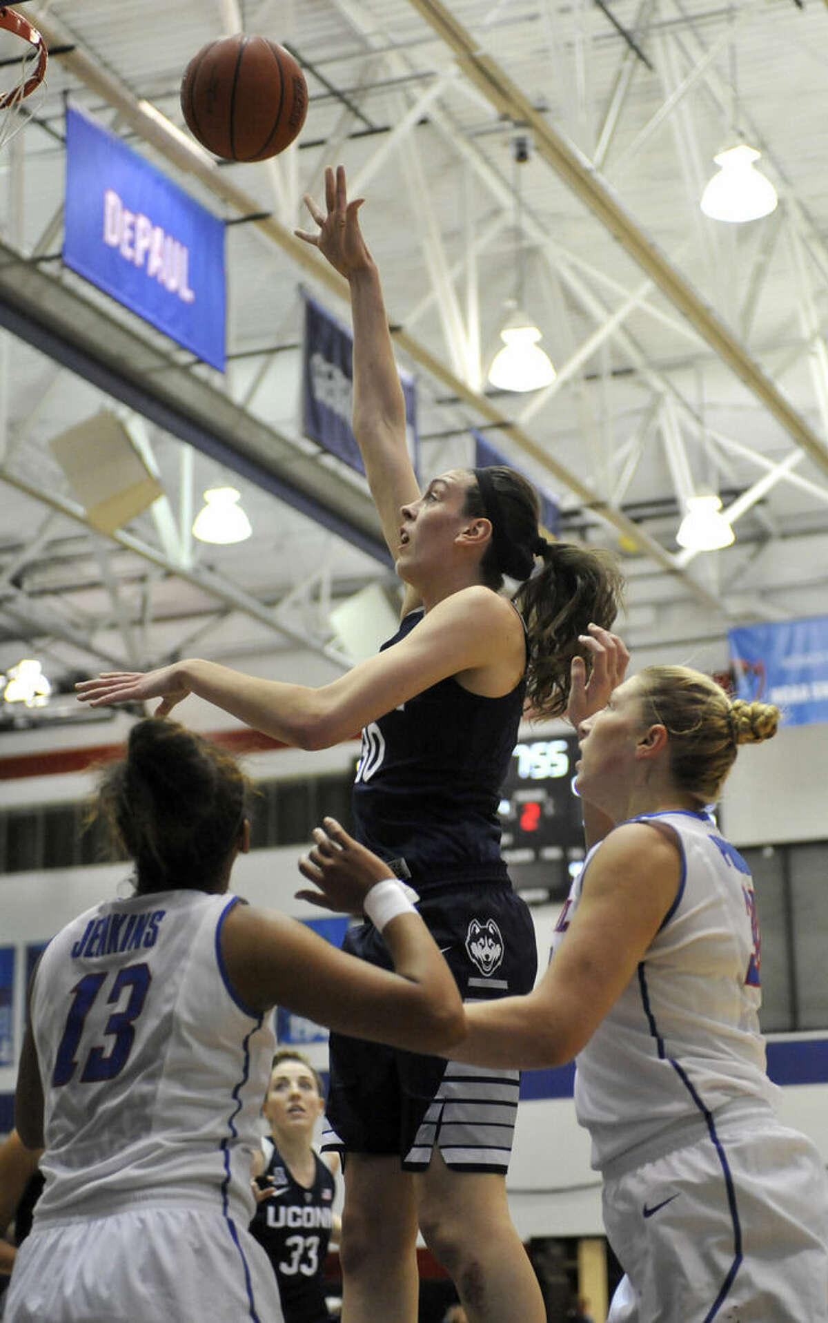 Connecticut's Breanna Stewart (30), shoots against DePaul's Chanise Jenkins (13), and Megan Podkowa (30), during the first half of an NCAA college basketball game Wednesday, Dec. 2, 2015, in Chicago. (AP Photo/Paul Beaty)
