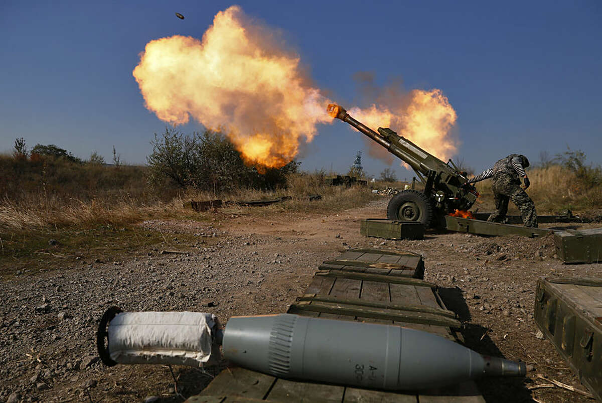 Pro-Russian rebels fire artillery toward Ukrainian position at Donetsk Sergey Prokofiev International Airport outskirts the city of Donetsk, eastern Ukraine Tuesday, Oct. 14, 2014. (AP Photo/Dmitry Lovetsky)