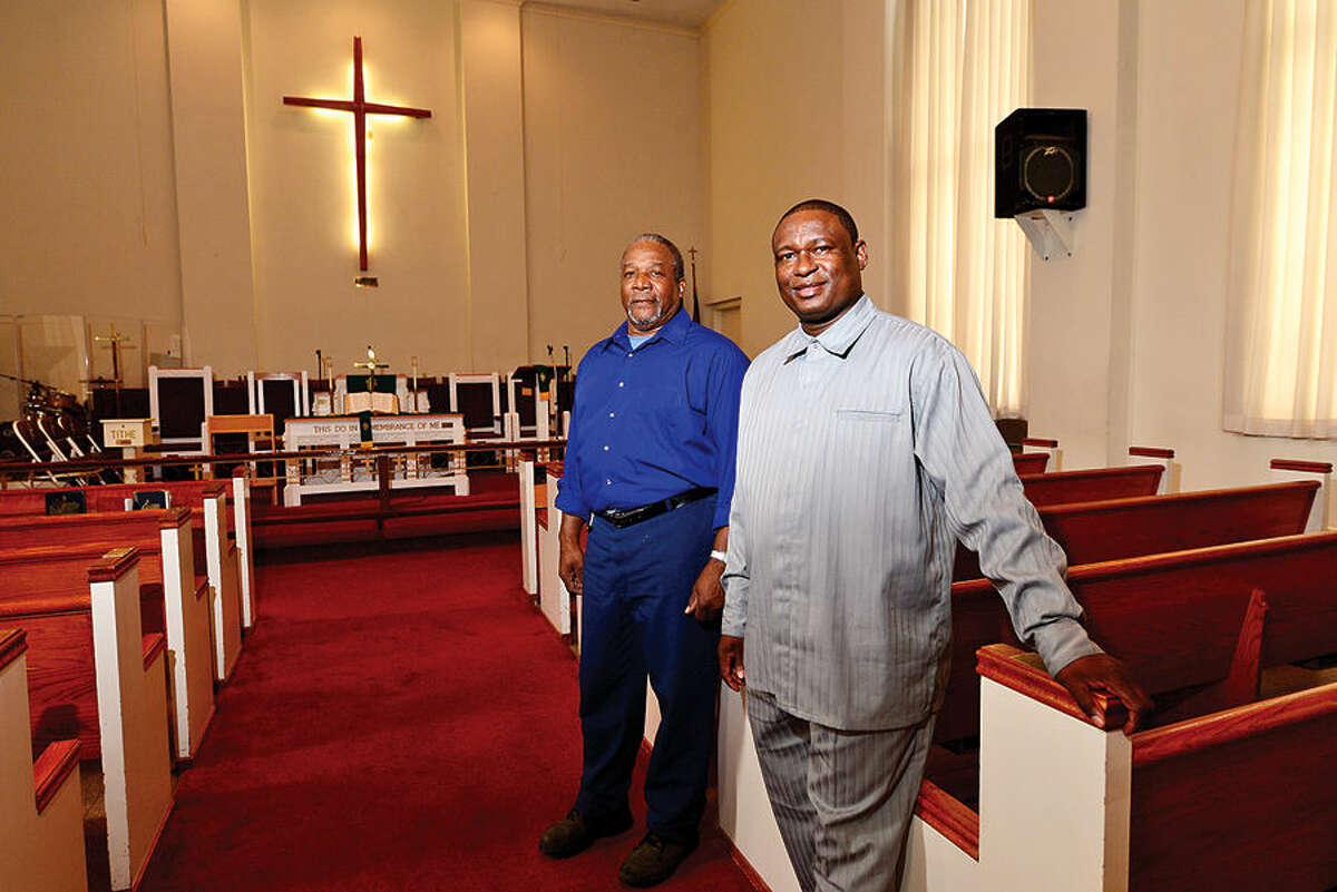 Hour photo / Erik Trautmann Andrew Robinson vice chairman of Bethel AME board of trustees and pastor Dr. Richard Wesley Clarke gear up for the 140th anniversary celebration of Bethel AME Church