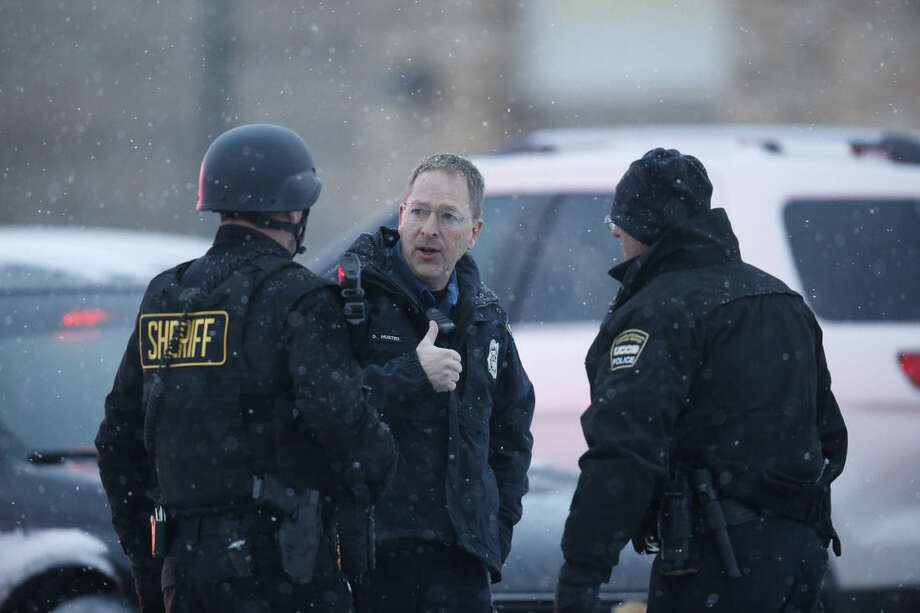 Police stand guard near a Planned Parenthood clinic Friday, Nov. 27, 2015, in Colorado Springs, Colo. A gunman opened fire at the clinic on Friday, authorities said, wounding multiple people. (AP Photo/David Zalubowski)