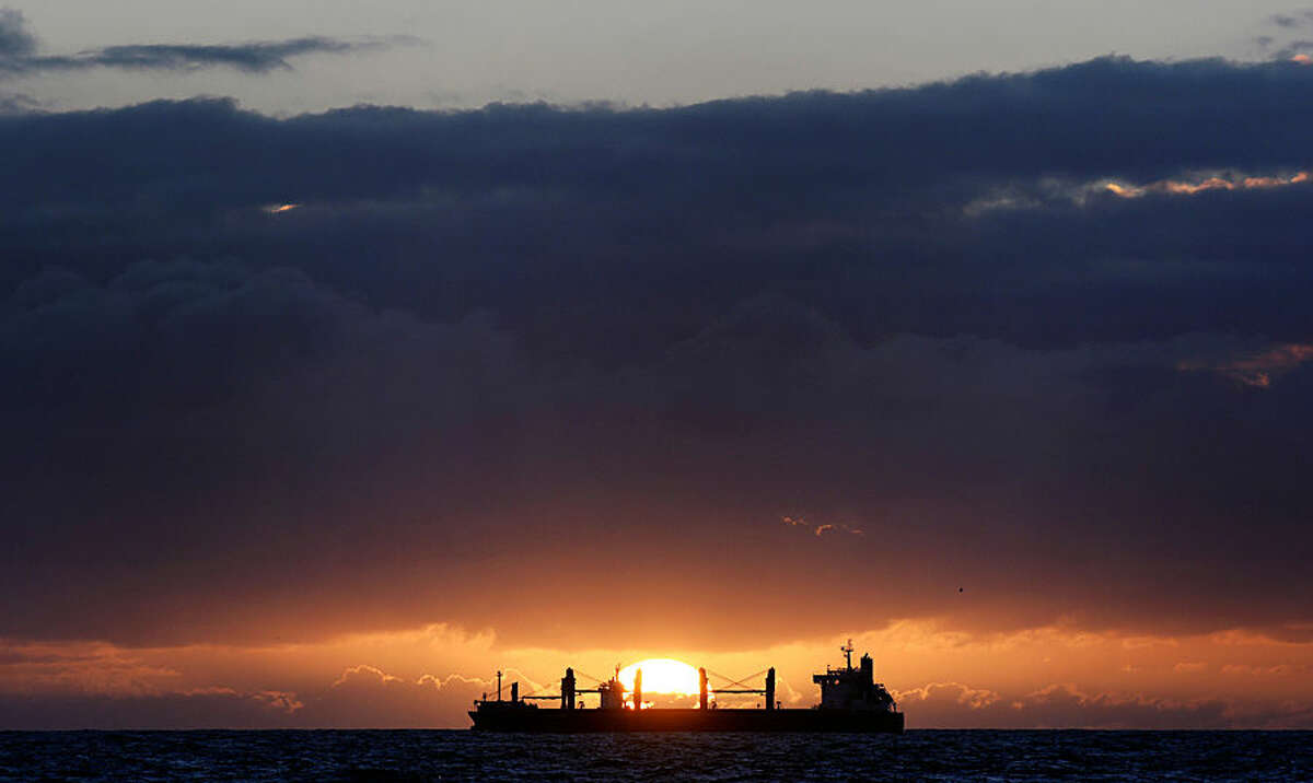 The sun rises behind a ship as it enters the North Sea from the river Tyne, near Tynemouth, England, Wednesday, Oct. 15, 2014. (AP Photo/PA, Owen Humphreys) UNITED KINGDOM OUT, NO SALES, NO ARCHIVE