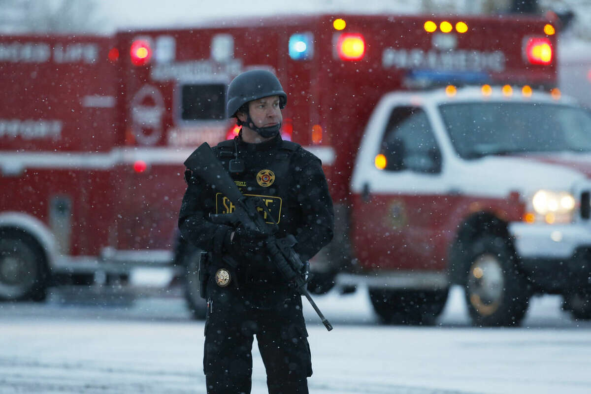 An officer stands guard near a Planned Parenthood clinic Friday, Nov. 27, 2015, in Colorado Springs, Colo. A gunman opened fire at the clinic on Friday, authorities said, wounding multiple people. (AP Photo/David Zalubowski)