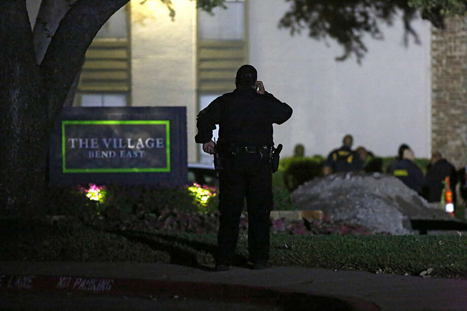 Emergency responders arrive at The Village Bend East apartments where a second healthcare worker tested positive for Ebola, Wednesday, Oct. 15, 2014, in Dallas. The worker at Texas Health Presbyterian Hospital was monitoring herself for symptoms, Dallas County Judge Clay Jenkins said. The unidentified woman reported a fever Tuesday. She was in isolation within 90 minutes, Jenkins said. (AP Photo/The Dallas Morning News, Nathan Hunsinger) MANDATORY CREDIT; MAGS OUT; TV OUT; INTERNET USE BY AP MEMBERS ONLY; NO SALES