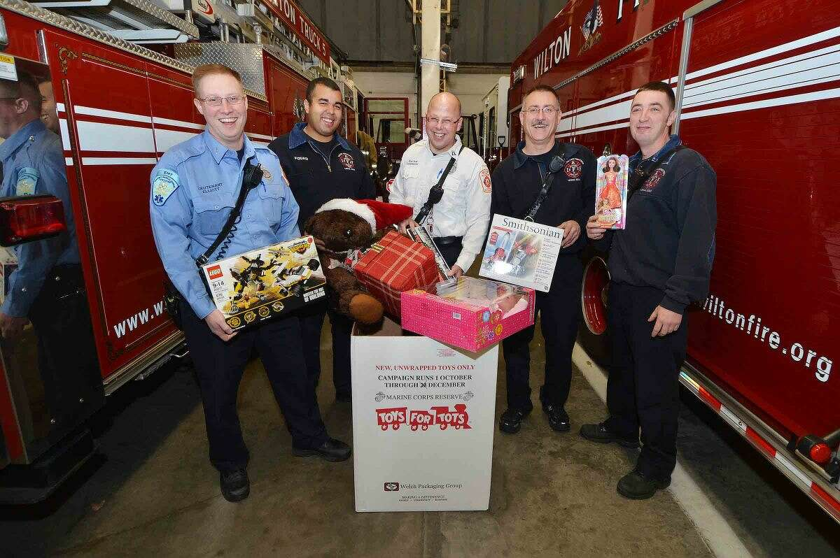 Toys for Tots kicks off at the Wilton Fire Department with Lt. Brian Elliott, Firefighter Noah Fouad, Capt. Kevin Czarnecki, Firefighter Gary Fuoco and Lt. Bill Wilson.