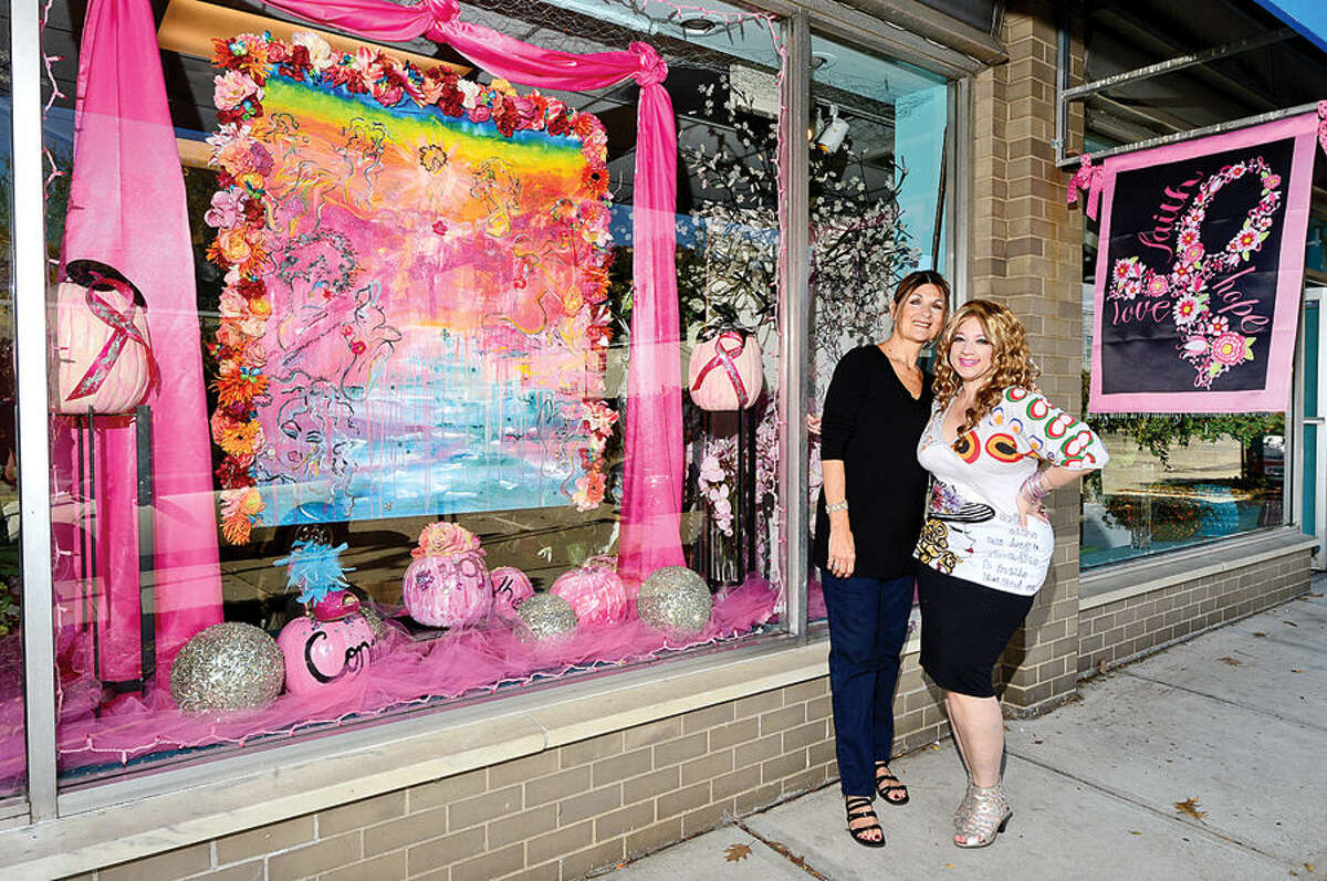 Hour photo / Erik Trautmann Danna DiElsi, floral designer of The Silk Touch in Norwalk and Vernice Holmes, fashion designer & artist of I am Vernice in Norwalk, collaborate to artistically celebrate life and honor those affected by breast cancer with a window display at Silk Touch on Main St.