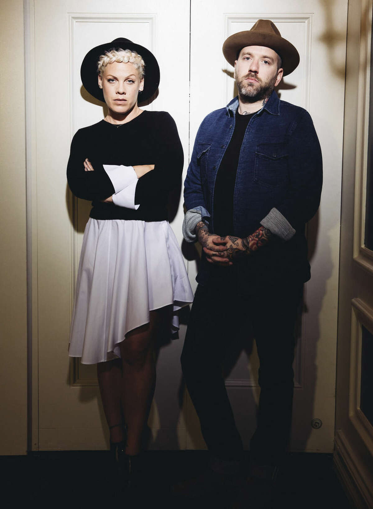 In this Friday, Oct. 10, 2014 photo, folk music duo You+Me, consisting of Alecia Moore, left, known as Pink, and Dallas Green pose for a portrait during an interview at The Viceroy Hotel in Santa Monica, Calif. The 35-year-old entertainer is just being herself in You+Me, her new acoustic project with the Canadian singer-songwriter Green. The duo releases their debut album,