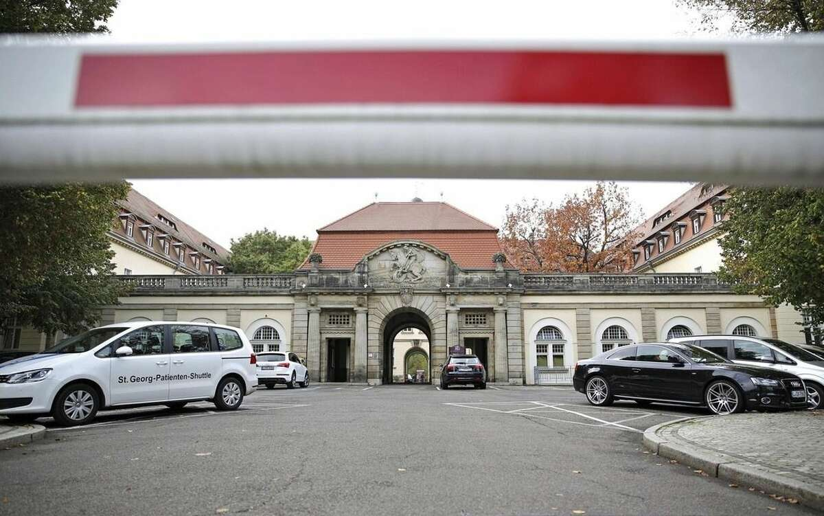A barrier blocks off the entrance to the St.Georg hospital, where an Ebola patient has died, in Leipzig, Germany, Tuesday, Oct. 14, 2014. The 56-year old United Nations medical worker who was infected with Ebola in Liberia has died despite