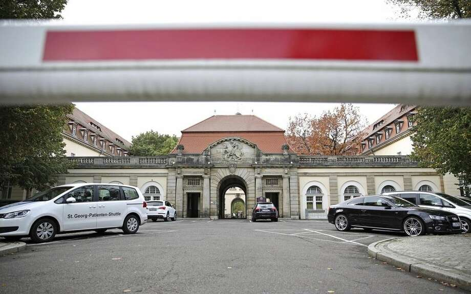 "A barrier blocks off the entrance to the St. Georg hospital, where an Ebola patient has died, in Leipzig, Germany, Tuesday, Oct. 14, 2014. The 56-year old United Nations medical worker who was infected with Ebola in Liberia has died despite ""intensive medical procedures,"" the German hospital said Tuesday. (AP Photo/dpa, Jan Woitas)"