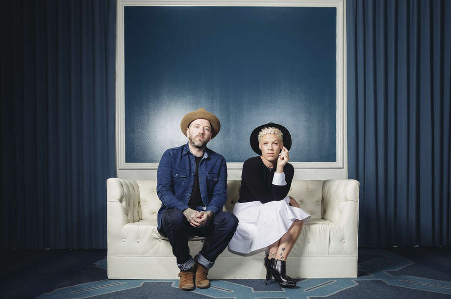 "In this Friday, Oct. 10, 2014 photo, folk music duo You+Me, consisting of Dallas Green, left, and Alecia Moore, known as Pink, pose for a portrait during an interview at The Viceroy Hotel in Santa Monica, Calif. The 35-year-old entertainer is just being herself in You+Me, her new acoustic project with the Canadian singer-songwriter Green. The duo releases its debut album, ""rose ave."" on Tuesday, Oct. 14, 2014. (Photo by Casey Curry/Invision/AP)"