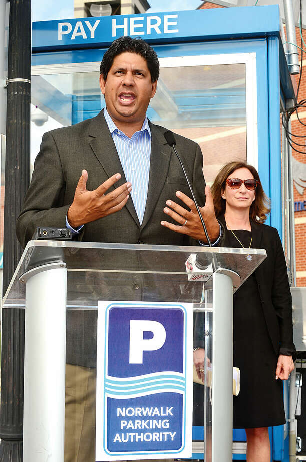 Hour photo / Erik Trautmann President & CEO of Streetline, Zia Yusuf, speaks during a press conference at the North Water St lot Tuesday as the Norwalk Parking Authority announces a new digital initiative that allows access to parking availability information with the smart phone application, Parker. The system works via wireless sensors that are embedded in parking space to detect whether or not the space is occupied. Data from each sensor is relayed via wireless to the cloud and pushed into an easy-to-use app showing real-time parking availability. CASE parking, a parking data solutions provider, will collect occupancy data from the lots and garages. Streetline, the leading global provider of sensor-based smart parking technology, has outfitted the on-street parking spaces with sensors. The data from both systems will be streamed directly into Streetline's mobile app, Parker.