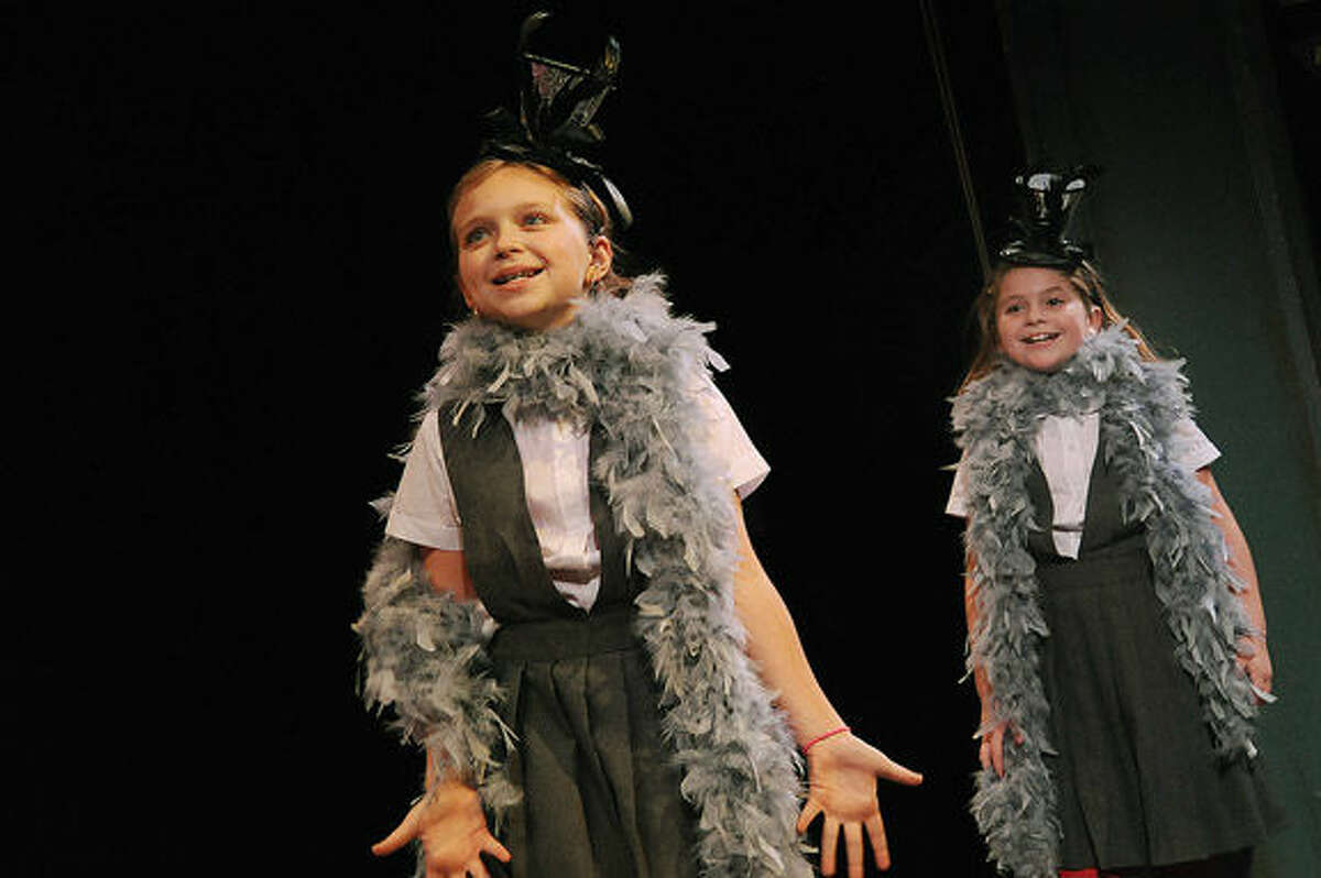 """Ella Savage and Nemi Freidman, students at Cider Mill School, rehearse for """"The 12 Days of Christmas,""""which debuts Tuesday night at the Wilton Playshop."""