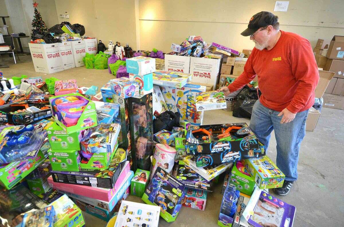 Hour Photo/Alex von Kleydorff Peter Havens, Retired U.S. Marine loads toys that were purchased on Black Friday at Norwalk's Toys R Us into an empty retail store on Monday. The toys will be sorted by age group and distributed to area kids in Norwalk, Westport, Fairfield and half of Wilton through the Toys for Tots program he has been volunteering with for the past 27 years, saying this may be his last year.