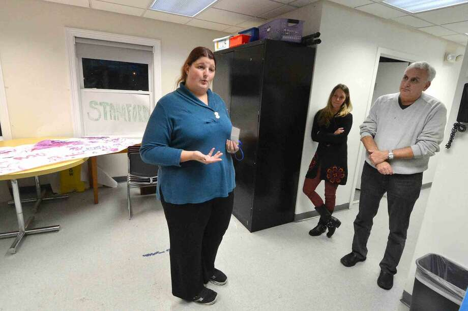 Hour Photo/Alex von Kleydorff Nicole Radice, Director of PROSPECTS extended day treatment program talks about the program with Child Guidance Center of Mid Fairfield County's CEO Roy Berger and Marissa Mangone, Director of Business Development