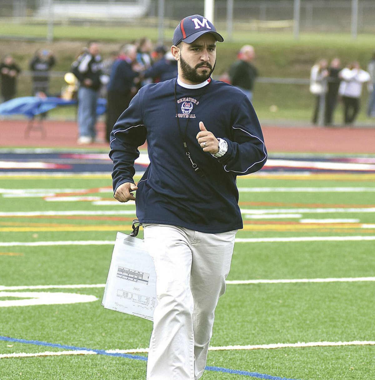 Hour photo/John Nash Brien McMahon football coach A.J. Albano nutured a young team through a growing season in 2015.