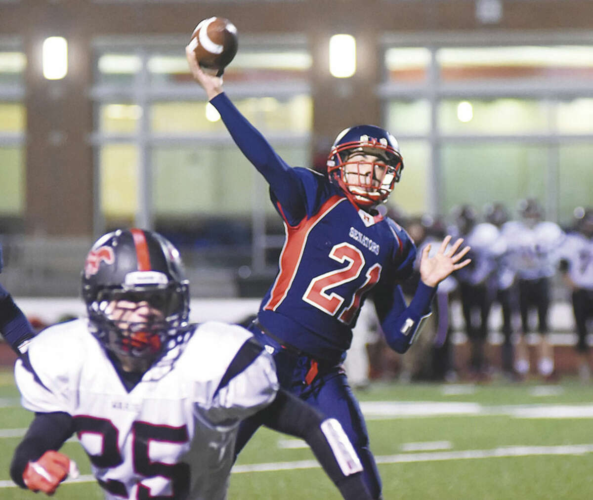 Hour photo/John Nash Brien McMahon sophomore quarterback Chris Druin gain a lot of valuable experience this season before getting hurt in the final week.