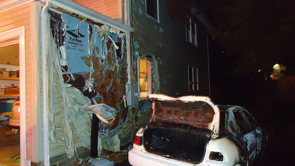 Contributed photo Norwalk Fire Department responded to this car fire that spread the siding of a house on North Bridge St. on Thursday.