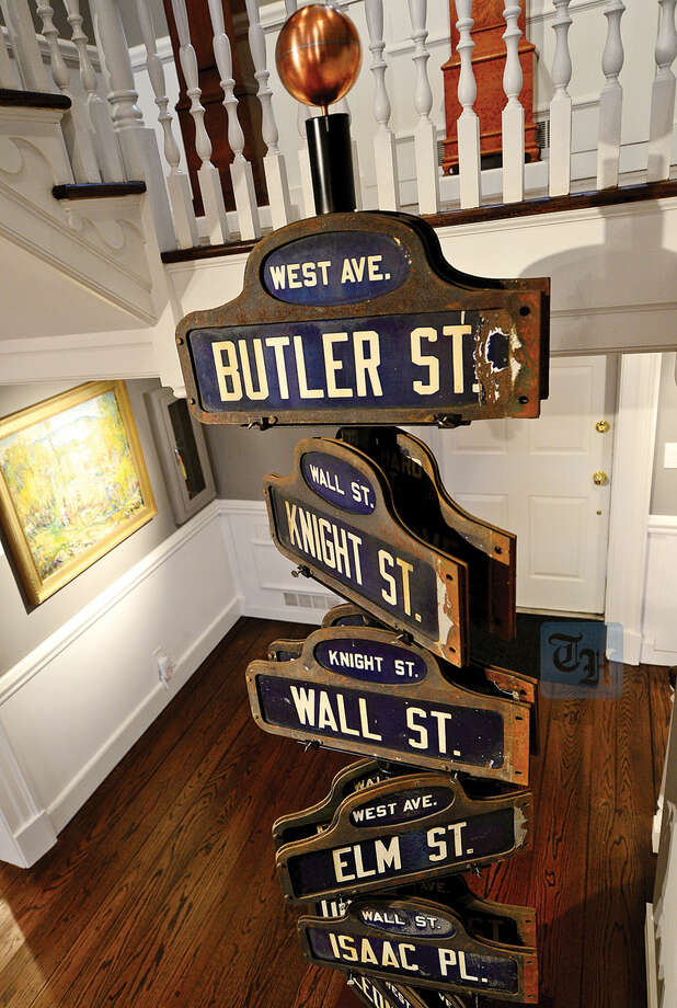 Hour photo / Erik Trautmann 1920 street signs grace the foyer of the new Norwalk Museum . The museum is to reopen Saturday at its new location at the Lockwood House adjacent to City Hall.