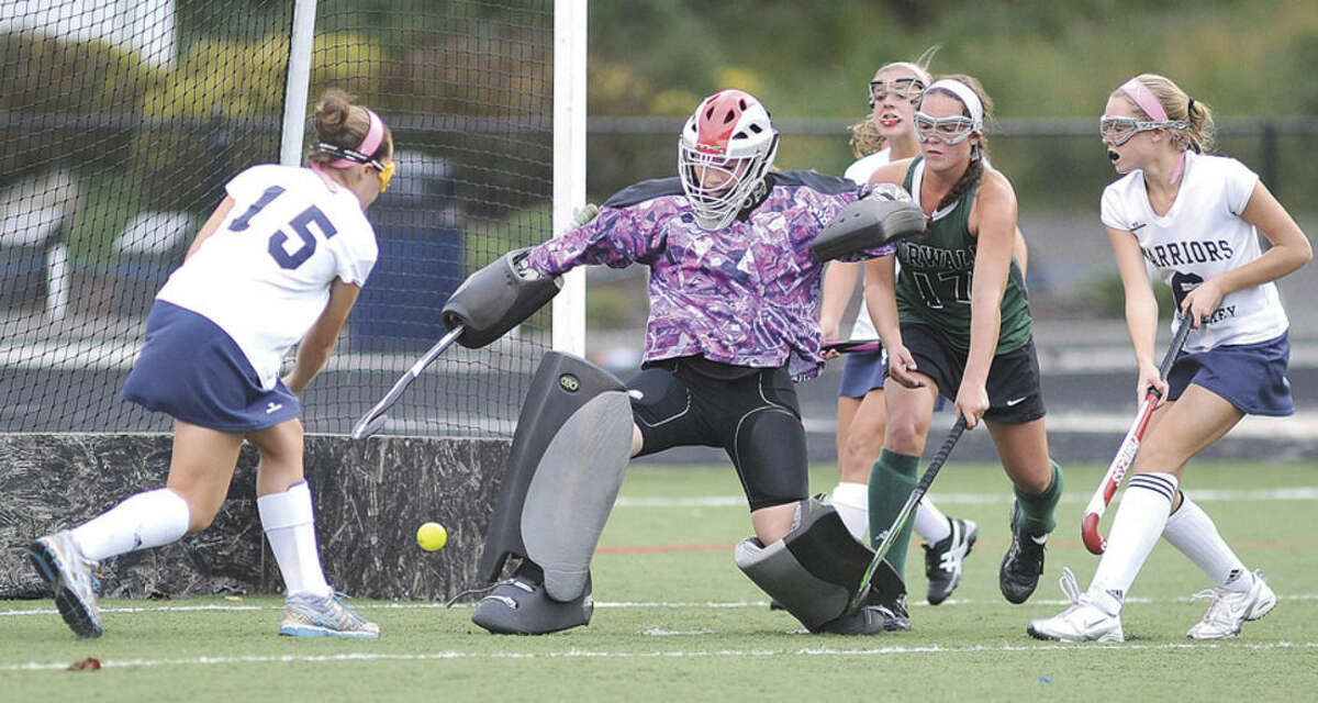 Hour photo/John Nash Wilton's Jillian Mahon (15) fires a shot past Norwalk goalie Samantha Troetti for the game-winning goal, giving the host Warriors a 2-1 win over the Bears. From right to left, Wilton's Bridget Ward and Norwalk's Alex Whalen look on.