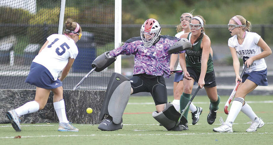Hour photo/John NashWilton's Jillian Mahon (15) fires a shot past Norwalk goalie Samantha Troetti for the game-winning goal, giving the host Warriors a 2-1 win over the Bears. From right to left, Wilton's Bridget Ward and Norwalk's Alex Whalen look on.