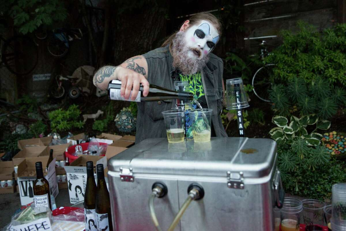 Chris Kimbrough pours drinks following a clown-themed burlesque show at The Stables at the Georgetown Carnival, Saturday, June 11, 2016.