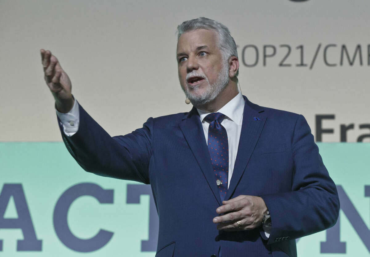 Premier of Quebec Canadian Phillippe Cuillard gestures as he speaks during the