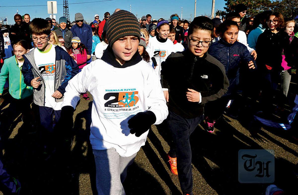 Hour photo / Erik Trautmann Local residents including Alexander Endres, 10, participate in the 1.2 mile 25th annual Norwalk River Fun Run at Veteran's Memorial Park in Norwalk Saturday.