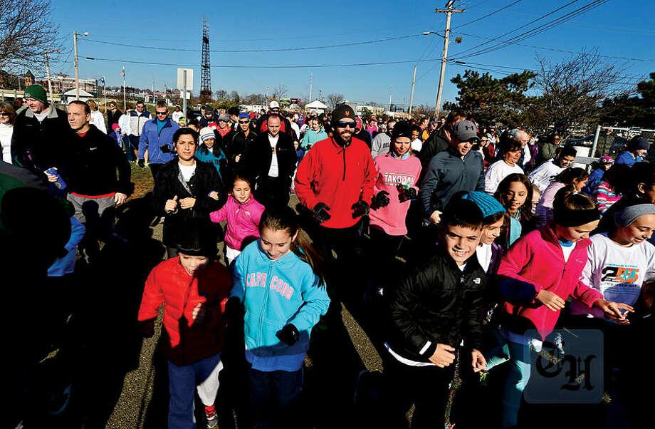 Hour photo / Erik Trautmann Local residents participate in the 1.2 mile 25th annual Norwalk River Fun Run at Veteran's Memorial Park in Norwalk Saturday.