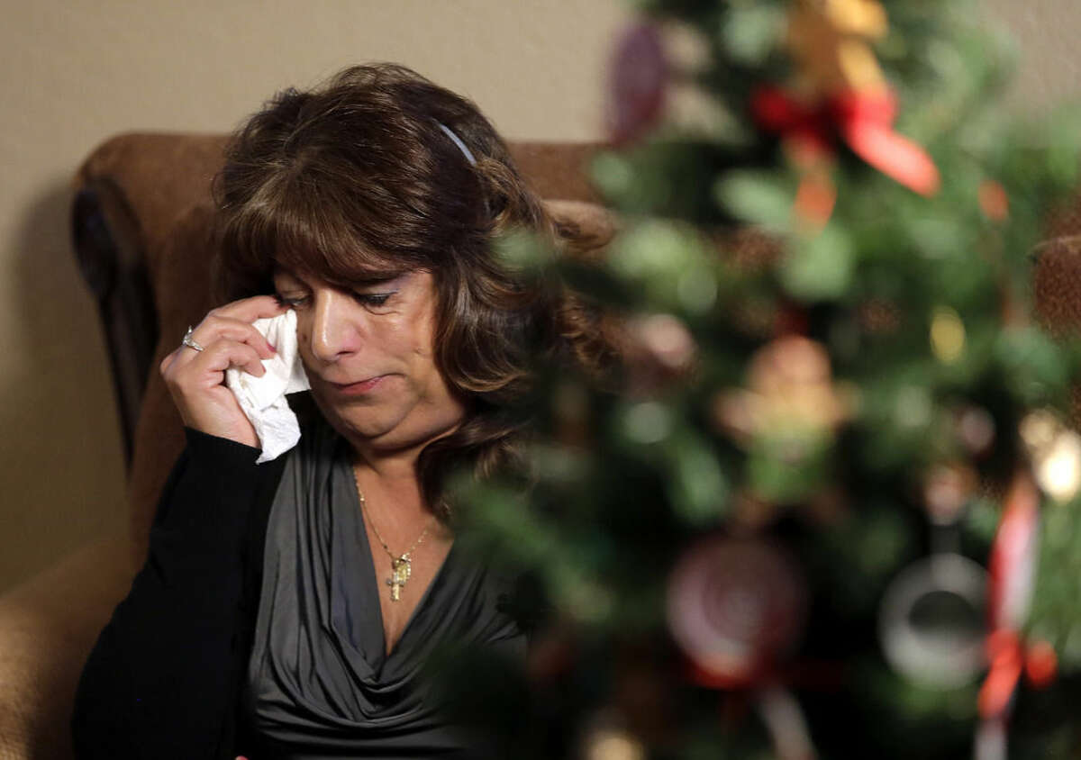 Regina Kuruppu reacts as she describes being on the second floor of Building 3 at the Inland Regional Center during Wednesday's shooting in San Bernardino, on Friday, Dec. 4, 2015, in Redlands, Calif. Huddled beneath a desk, Kuruppu held tightly to her co-workers' hands and began to pray aloud, unable to drown out the terrified screams coming from one story below as the shooting rampage took place. (AP Photo/Chris Carlson)