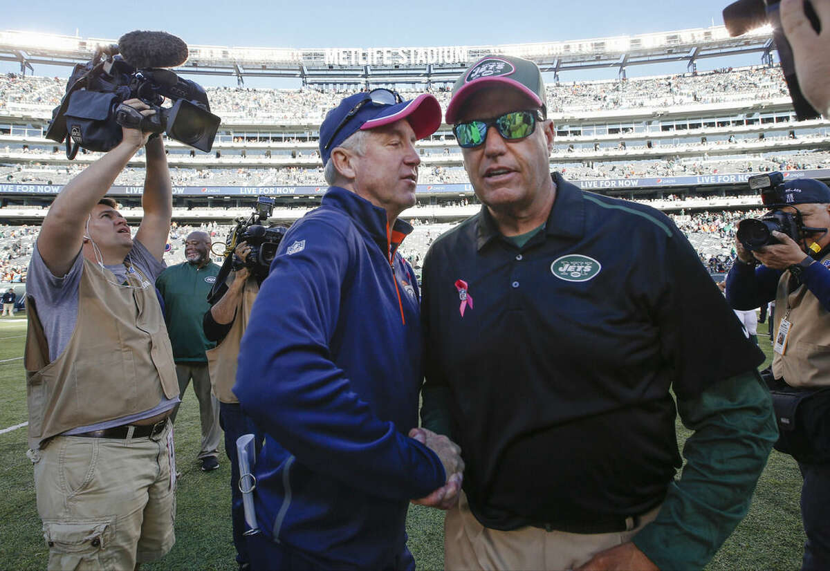 Denver Broncos head coach John Fox, left, greets New York Jets head coach Rex Ryan after an NFL football game, Sunday, Oct. 12, 2014, in East Rutherford, N.J. The Broncos won 31-17. (AP Photo/Kathy Willens)