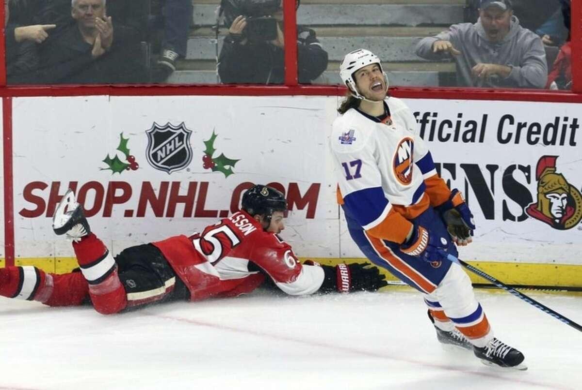New York Islanders' Matt Martin (17) reacts after drawing a penalty on Ottawa Senators' Erik Karlsson late in third period NHL action in Ottawa, Saturday, Dec. 5, 2015. (Fred Chartrand/The Canadian Press via AP)