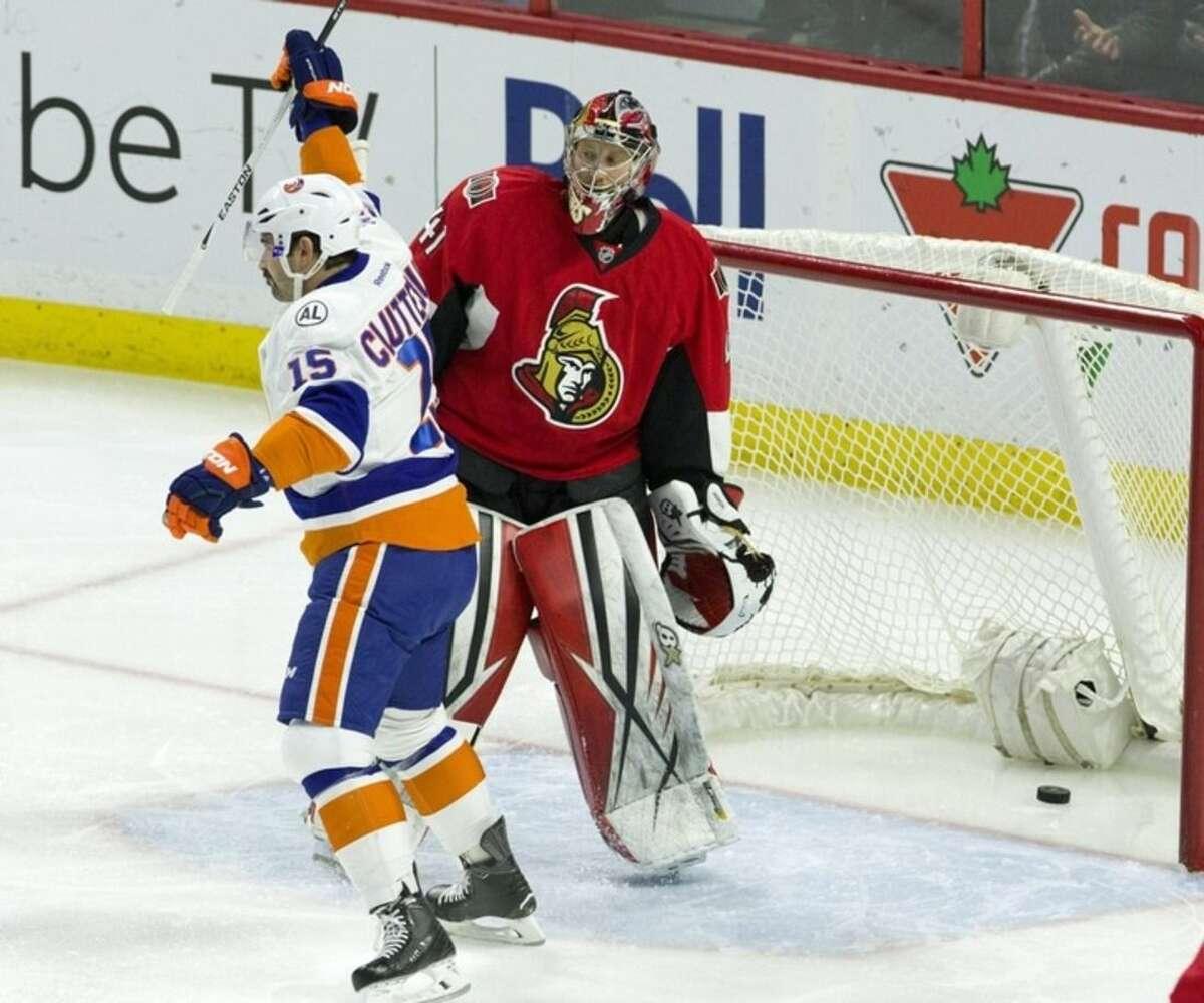 New York Islanders' Cal Clutterbuck (15) celebrates a goal by teammate Matt Martin, not shown, as Ottawa Senators goalie Craig Anderson reacts during first period NHL action in Ottawa Saturday, Dec. 5, 2015. (Fred Chartrand/The Canadian Press via AP)