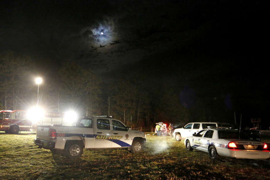 Emergency personnel work at the site of a hayride rollover that injured multiple people Harvest Hill Farms in Mechanic Falls on Route 126, Saturday, Oct. 11, 2014. Police in Maine confirm a teen has died and two remain in critical condition after the crash. At least 20 other passengers were taken to area hospitals for treatment. (AP Photo/Maine Today, Gabe Souza) NO SALES