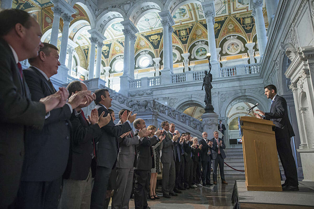 Members of Congress stand and applaud as new House Speaker Paul Ryan of Wis. calls for a bold pro-growth agenda as he delivers his first major policy speech since talking over the gavel just over a month ago, Thursday, Dec. 3, 2015, at the Library of Congress on Capitol Hill in Washington. (AP Photo/J. Scott Applewhite)