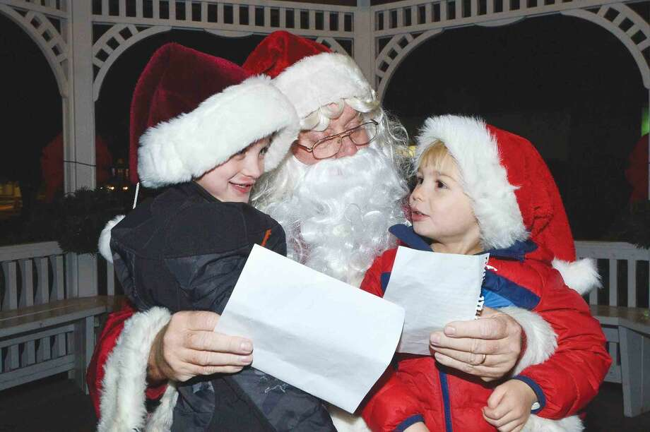 Hour Photo/Alex von Kleydorff Cooper and Tucker Rekow have their lists for Santa including a puppy for Christmas during the Wilton tree lighting and Holiday Stroll on friday night