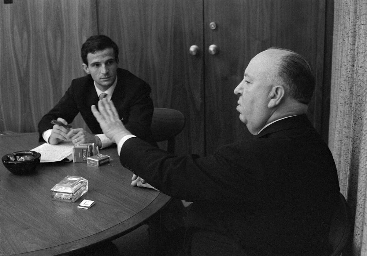 This 1962 image released by Cohen Media Group shows Francois Truffaut, left, and director Alfred Hitchcock in a scene from Kent Jones's documentary,