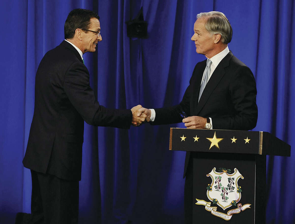 AP photo/Jessica Hill Incumbent Democrat Gov. Dannel P. Malloy, left, and Republican candidate for governor Tom Foley greet at the end of a debate Thursday, in Hartford.