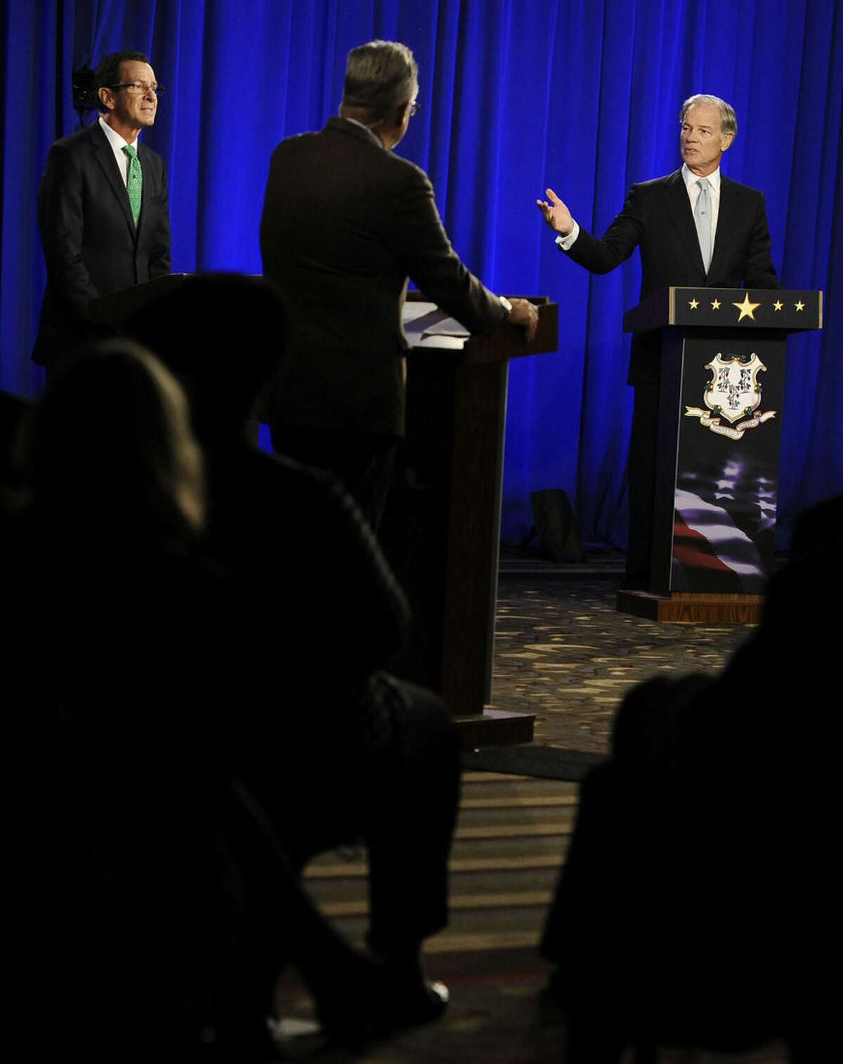 Republican candidate for governor Tom Foley, right, gestures as incumbent Democrat Gov. Dannel P. Malloy, left, listens, during a debate, Thursday, Oct. 9, 2014, in Hartford, Conn. (AP Photo/Jessica Hill)