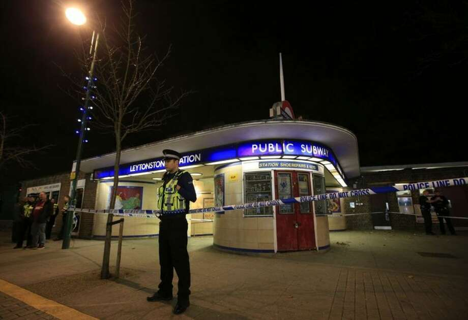 "Police cordon off Leytonstone Underground Station in east London following a stabbing incident, Saturday Dec. 5, 2015. The stabbing is being treated as a ""terrorist incident,"" the London police said Saturday. The London police counterterror command said in a statement that it is investigating the incident in which a man was threatening people with a knife at around 7 p.m. (1900 GMT; 2 p.m. EST). One person sustained serious injuries and two others received minor injuries. (Jonathan Brady/PA via AP) UNITED KINGDOM OUT NO SALES NO ARCHIVE"