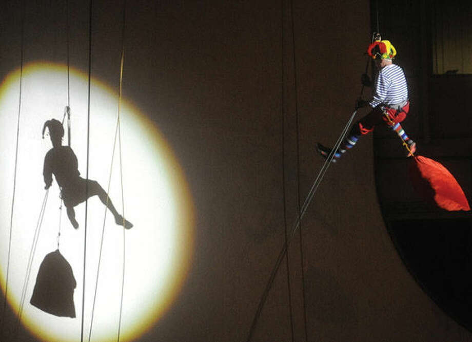 "New York Yankees general manager Brian Cashman as ""Cash The Elf"" rappels down the Landmark Building in Stamford Sunday at the annual Heights and Lights event. Hour photo/Matthew Vinci"