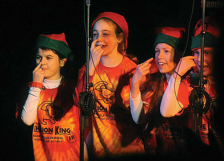 The cast of The Lion King Jr. from Saxe Middle School sings holiday songs Sunday at Latham Park in Stamford for the annual tree lighting. Photo/Matthew Vinci