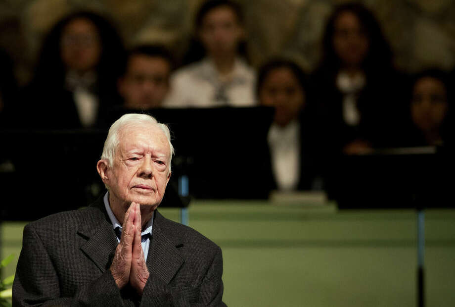 FILE - In a Sunday, Aug. 23, 2015 file photo, former President Jimmy Carter teaches Sunday School class at Maranatha Baptist Church in his hometown, in Plains, Ga. Former President Carter said Sunday, Dec. 6, 2015, that no cancer was detected in his latest scan. (AP Photo/David Goldman, File)