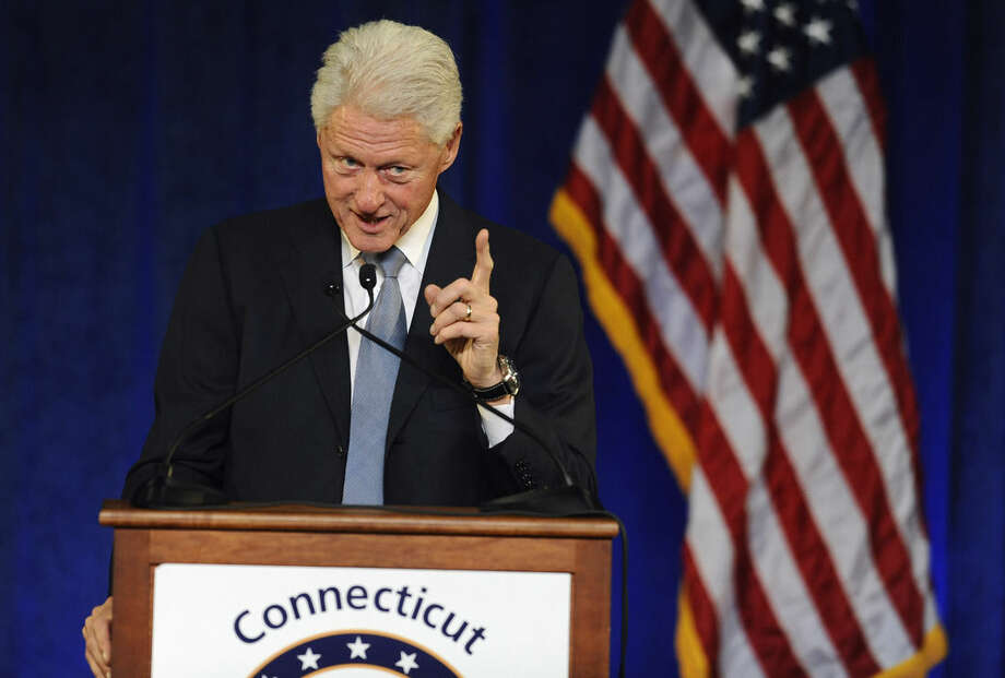 Former President Bill Clinton gestures as he speaks at a rally for Gov. Dannel P. Malloy, Monday, Oct. 13, 2014, in Hartford, Conn. (AP Photo/Jessica Hill)