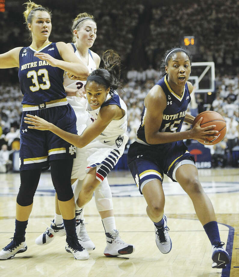 AP photoNotre Dame's Lindsay Allen, right, drives to the basket as UConn's Moriah Jefferson, center, is trapped between Notre Dame's Kathryn Westbeld, left, and UConn's Katie Lou Samuelson during the first half of Saturday's game in Storrs. Jefferson's defense helped carry the Huskies to a 91-81 win over the Irish.