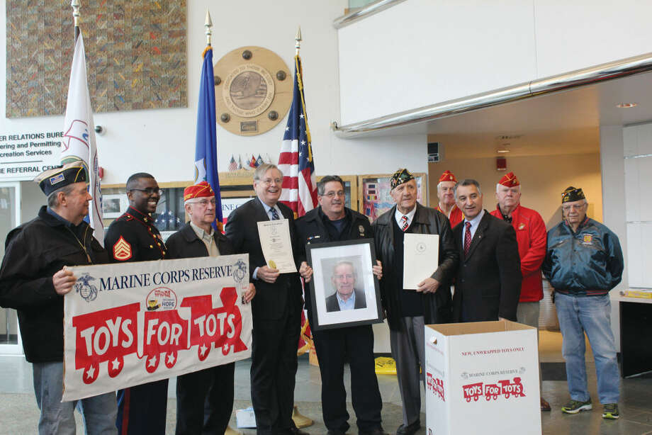Mayor David Martin, George Ducanic and state Sen. Carlo Leone kick off Toys for Tots Month at the Stamford Government Center.