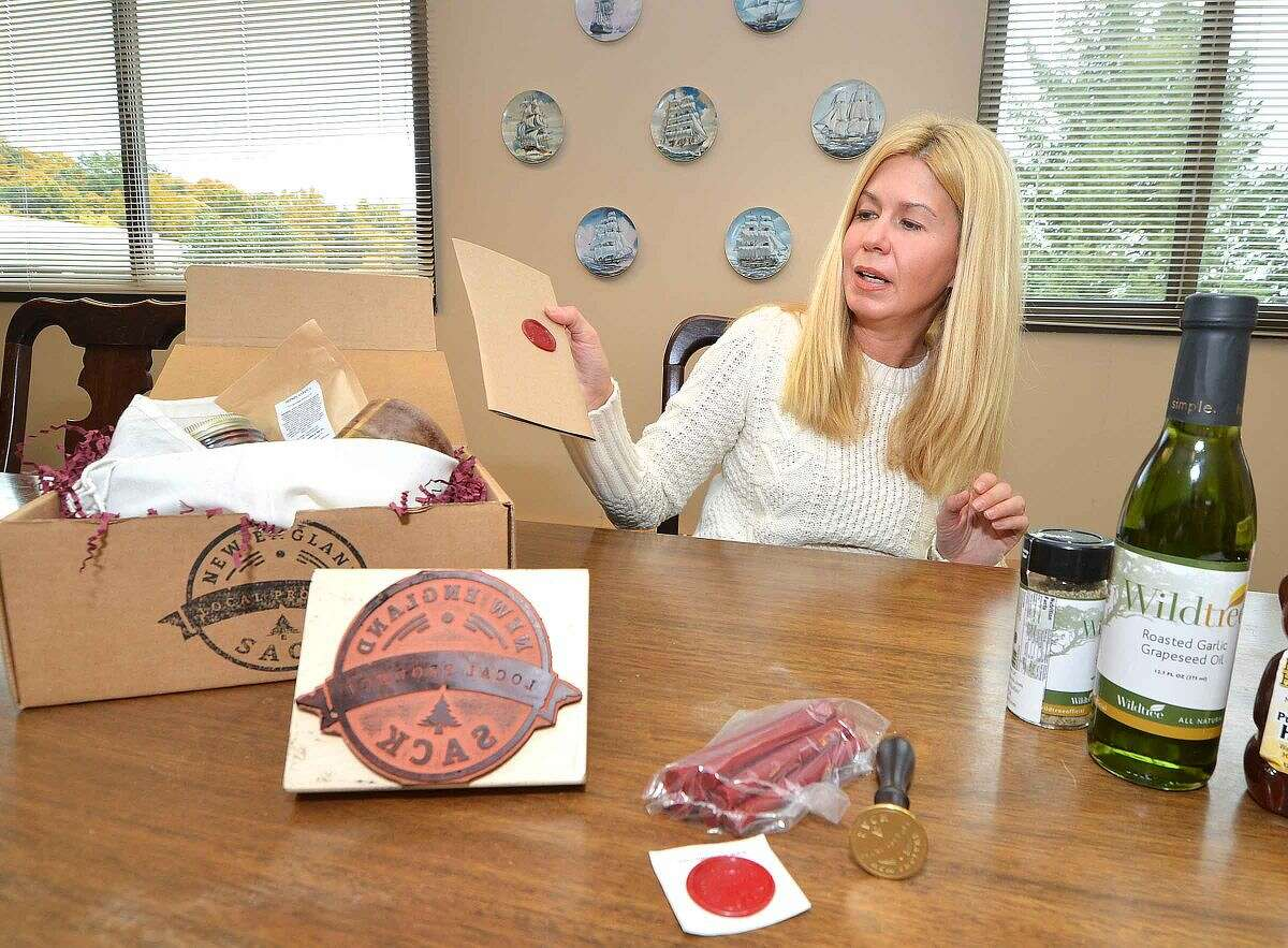 New England Sack founder Jennifer Halpin with some of the items included in her New England gift box.