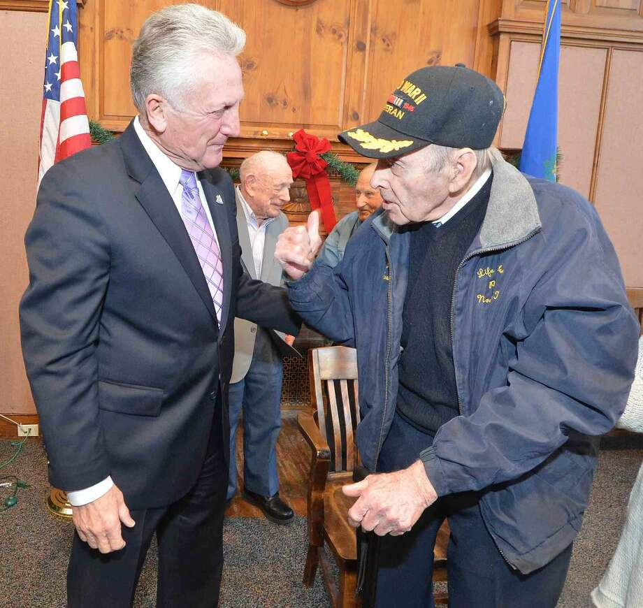 Hour Photo/Alex von Kleydorff Mayor Harry Rilling talks with World War II Army Veteran at the City's Pearl Harbor Remembrance Day event at City Hall